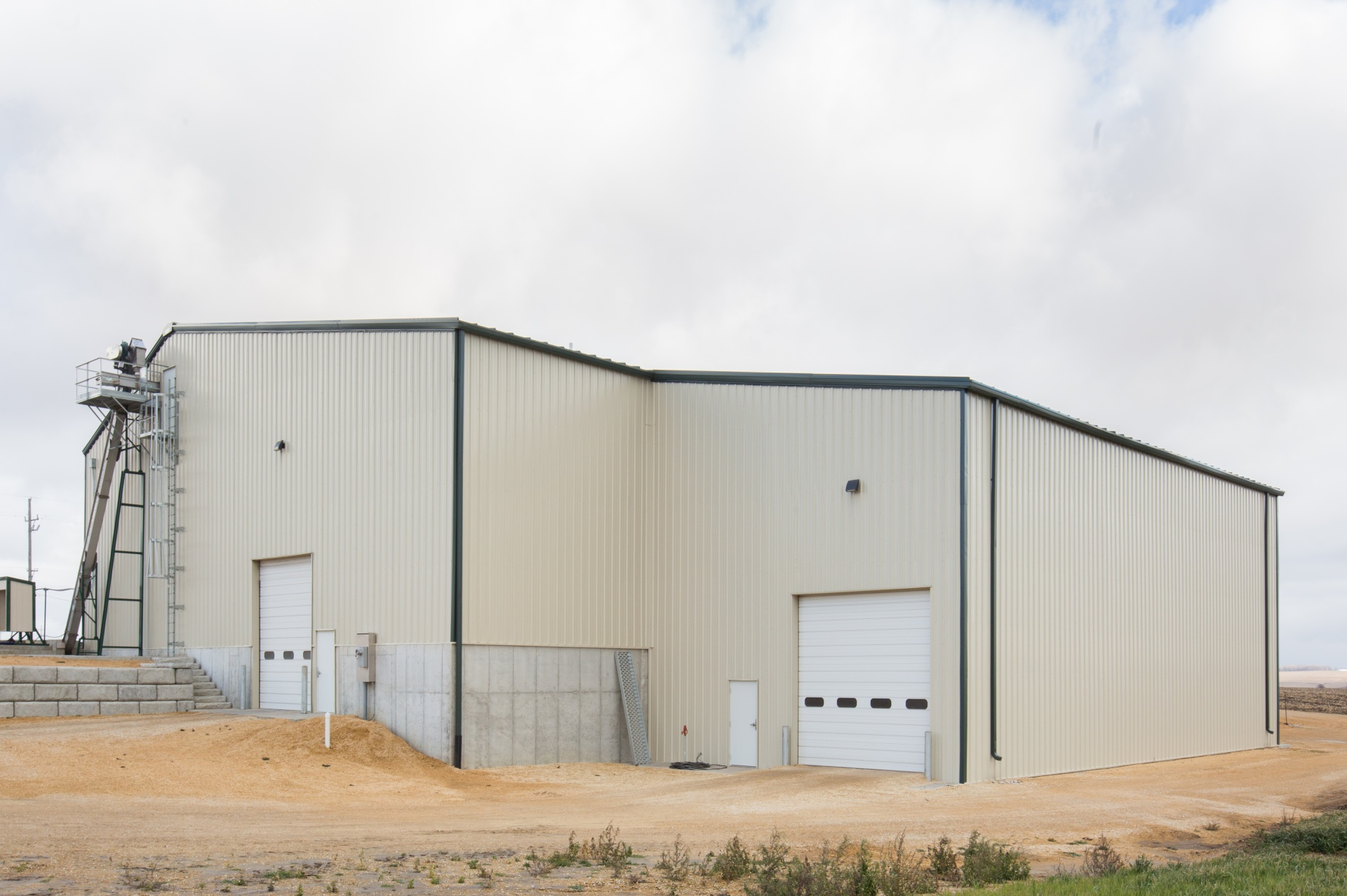 industrial building constructed with metal siding and trim and poured concrete floors